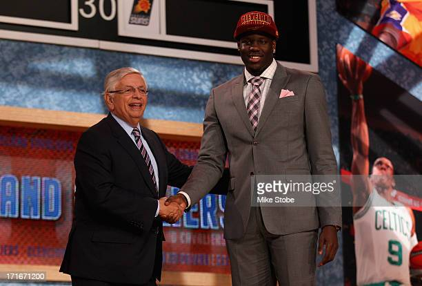 Anthony Bennett of UNLV poses for a photo with NBA Commissioner David Stern after Bennett was drafted overall by the Cleveland Cavaliers during the...