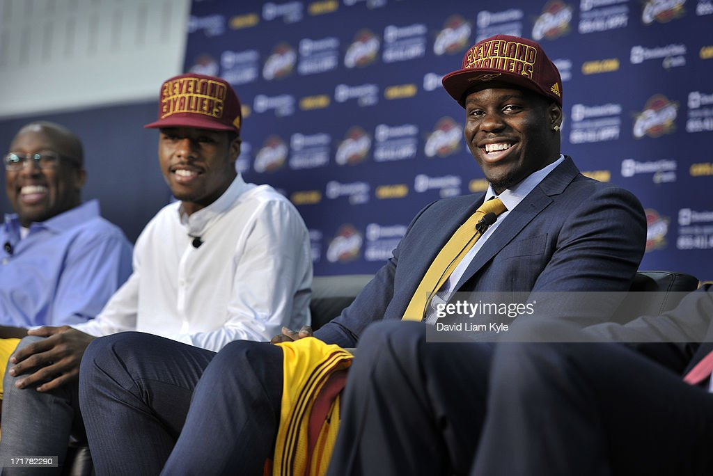 Anthony Bennett #12, the #1 overall pick of the 2013 NBA Draft by the Cleveland Cavaliers, answers questions alongside head coach Mike Brown and fellow draftee Carrick Felix #30 at The Cleveland Clinic Courts on June 28, 2013 in Independence, Ohio.