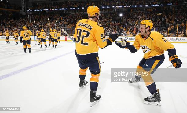 Anthony Bitetto and Ryan Johansen of the Nashville Predators celebrate a 32 shootout win against the Montreal Canadiens during an NHL game at...