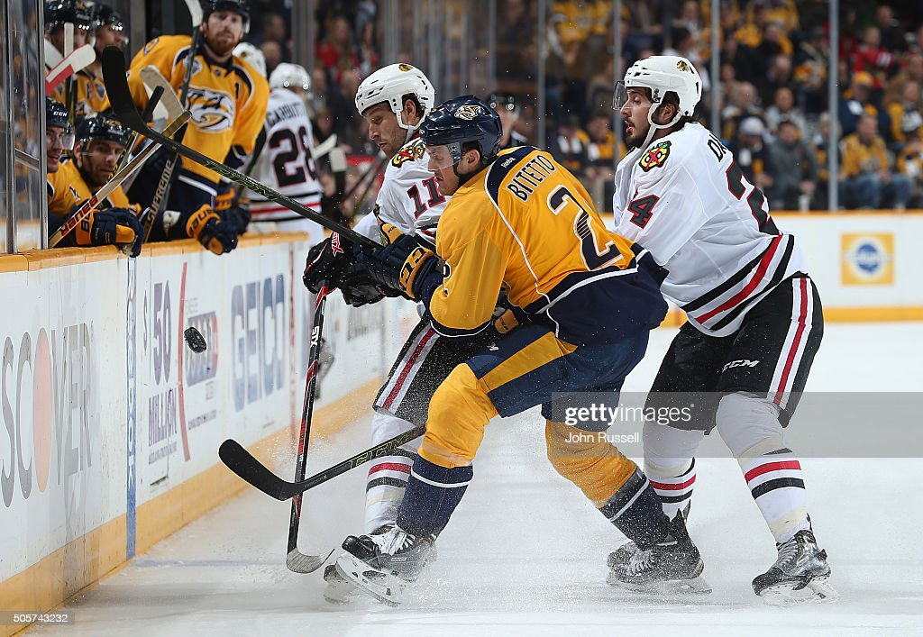 Anthony Bitetto #2 of the Nashville Predators battles for the puck against Phillip Danault #24 and Andrew Desjardins #11 of the Chicago Blackhawks during an NHL game at Bridgestone Arena on January 19, 2016 in Nashville, Tennessee.