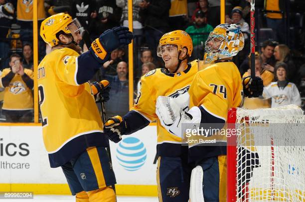 Anthony Bitetto Viktor Arvidsson and Juuse Saros of the Nashville Predators celebrate a 30 win against the Minnesota Wild during an NHL game at...