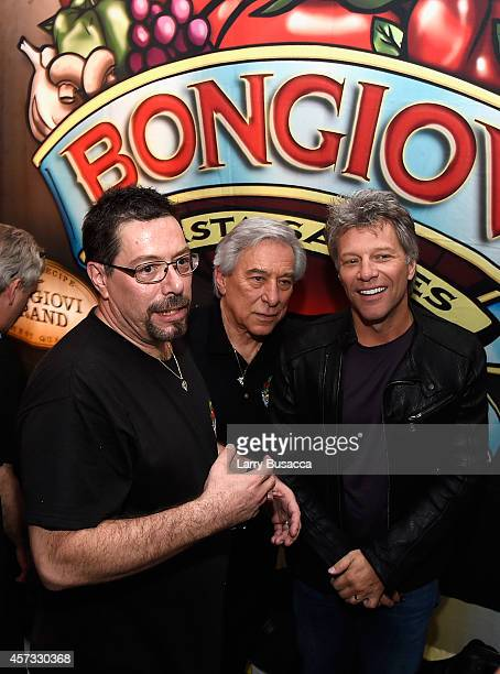 Anthony Bongiovi John Francis Bongiovi Sr and Jon Bon Jovi pose at the Bongiovi Brand chef station at Ronzoni's La Sagra Slices hosted by Bongiovi...