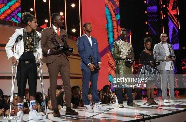 Anthony Borges James Shaw Jr Justin Blackman Mamadou Gassama Naomi Wadler and Shaun King are honored onstage at the 2018 BET Awards at Microsoft...