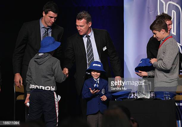 Anthony Boric and Coach Sir John Kirwan present young kids with hats during the 2013 Blues squad announcement at Eden Park on October 31 2012 in...