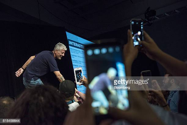 Anthony Bourdain host of CNNs Parts Unknown greets attendees during the South By Southwest Interactive Festival at the Austin Convention Center in...
