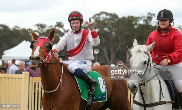 Anthony Boyd returns to the mounting yard on Hospeda after winning Ballarat Conveyancing BM58 Handicapat Avoca Racecourse on October 21 2017 in Avoca...
