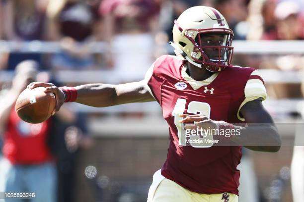 Anthony Brown of the Boston College Eagles looks for a pass against the Massachusetts Minutemen at Alumni Stadium on September 1 2018 in Chestnut...