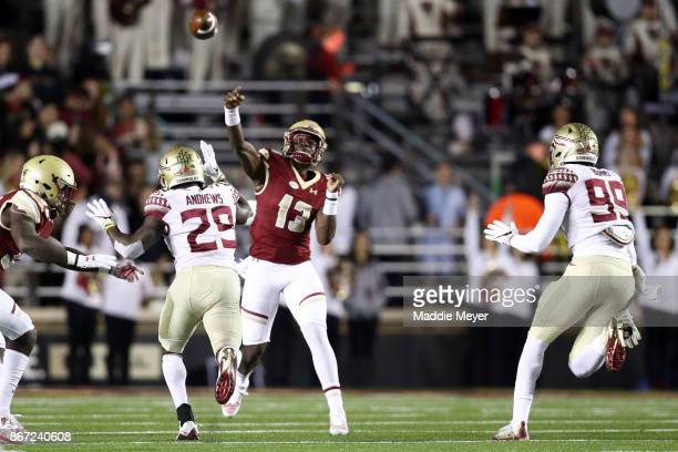 Anthony Brown of the Boston College Eagles makes a pass over Nate Andrews of the Florida State Seminoles during the first quarter at Alumni Stadium...