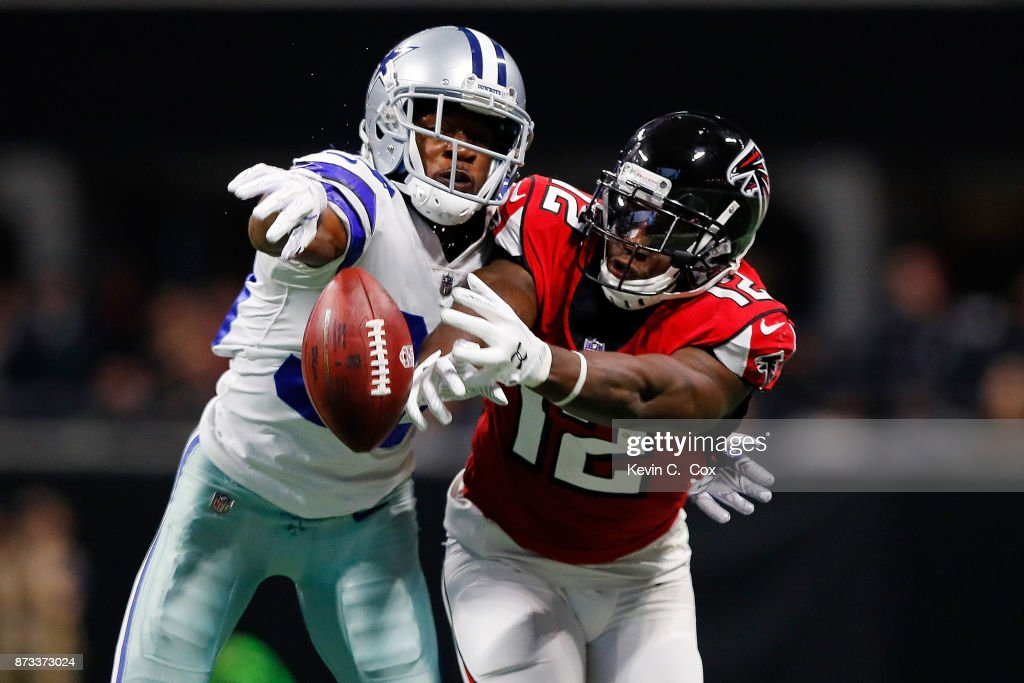 Anthony Brown #30 of the Dallas Cowboys breaks up a pass intended for Mohamed Sanu #12 of the Atlanta Falcons during the first half at Mercedes-Benz Stadium on November 12, 2017 in Atlanta, Georgia.