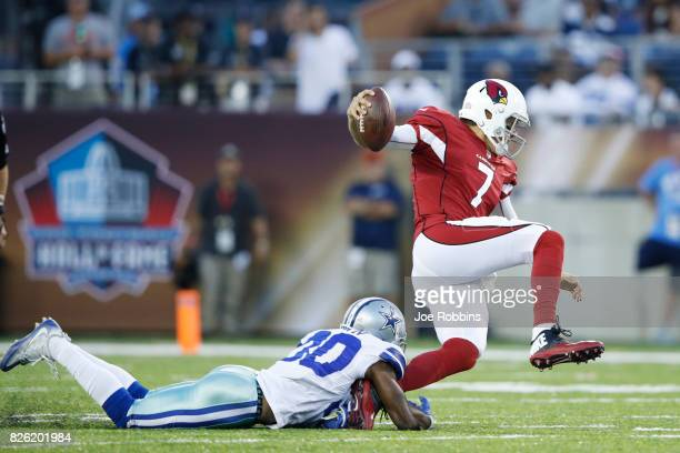 Anthony Brown of the Dallas Cowboys sacks Blaine Gabbert of the Arizona Cardinals in the first quarter of the NFL Hall of Fame preseason game at Tom...