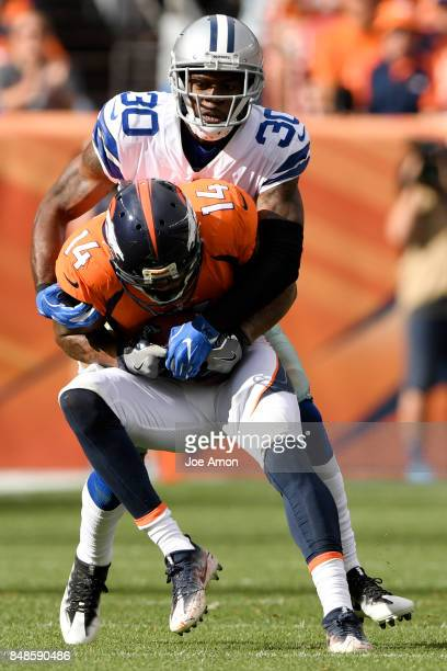 Anthony Brown of the Dallas Cowboys tackles Cody Latimer of the Denver Broncos during the second quarter on Sunday September 17 2017 The Denver...