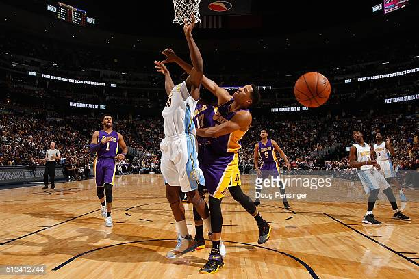 Anthony Brown of the Los Angeles Lakers commits a flagrant foul type one against Kenneth Faried of the Denver Nuggets in the second quarter at Pepsi...