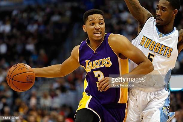 Anthony Brown of the Los Angeles Lakers controls the ball against Will Barton of the Denver Nuggets at Pepsi Center on March 2 2016 in Denver...