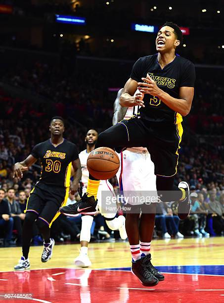 Anthony Brown of the Los Angeles Lakers is fouled as he drives to the basket during the game against the Los Angeles Clippers at Staples Center on...