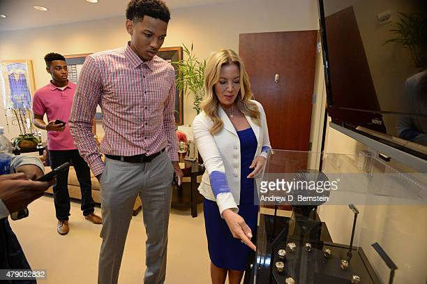 Anthony Brown of the Los Angeles Lakers poses for a photo with Jeanie Buss partowner and president before they attend a press conference at Toyota...