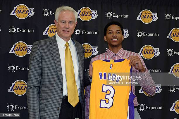 Anthony Brown of the Los Angeles Lakers poses for a photo with Lakers GM Mitch Kupchak at a press conference introducing draft picks at Toyota Sports...