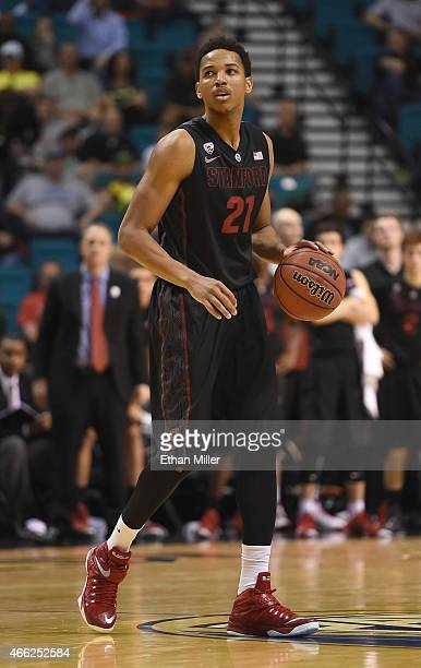 Anthony Brown of the Stanford Cardinal brings the ball up the court against the Utah Utes during a quarterfinal game of the Pac12 Basketball...