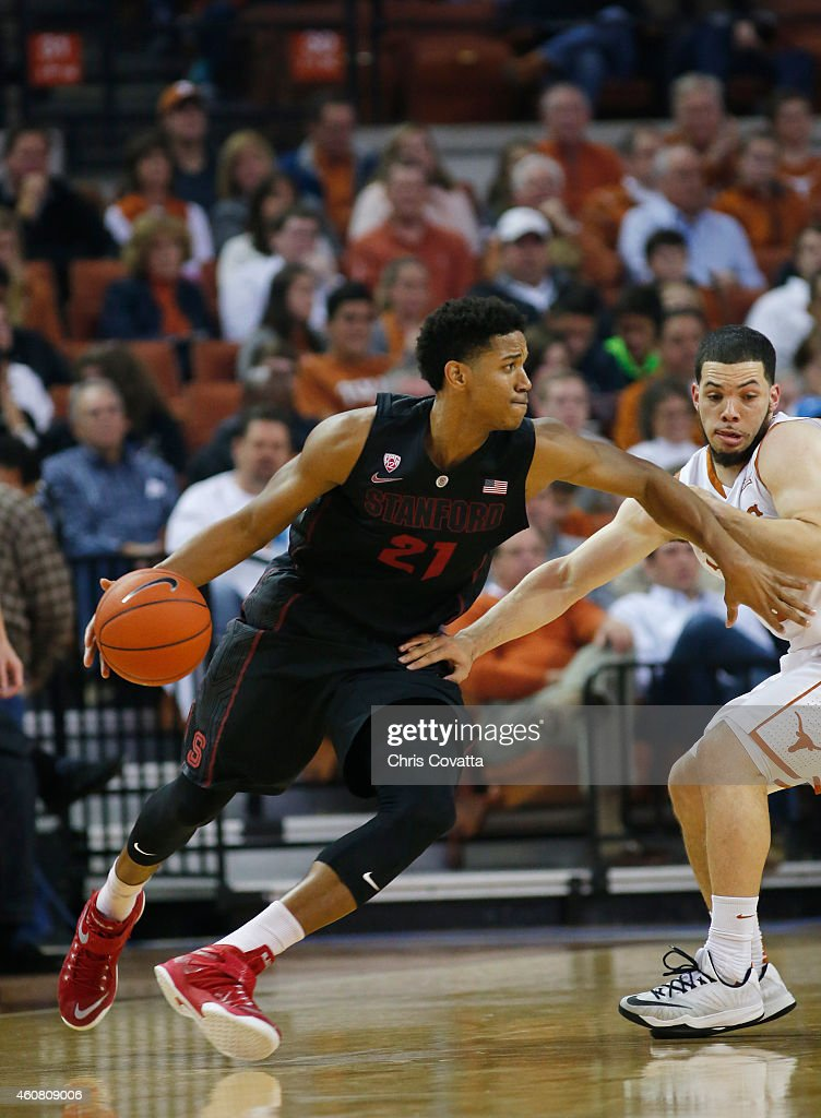 Anthony Brown #21 of the Stanford Cardinal drives around Javan Felix #3 of the Texas Longhorns at the Frank Erwin Center on December 23, 2014 in Austin, Texas.