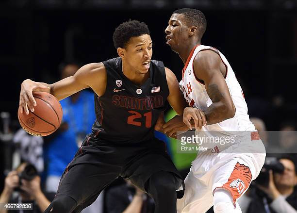 Anthony Brown of the Stanford Cardinal is guarded by Delon Wright of the Utah Utes during a quarterfinal game of the Pac12 Basketball Tournament at...