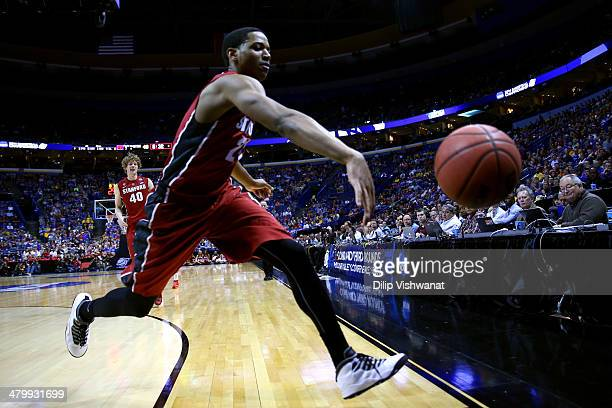 Anthony Brown of the Stanford Cardinal reaches for an out of bounds ball against the New Mexico Lobos during the second round of the 2014 NCAA Men's...