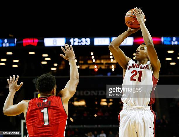 Anthony Brown of the Stanford Cardinal takes a shot as Rashad Vaughn the UNLV Rebels defends during the first half of a game in the Coaches vs Cancer...