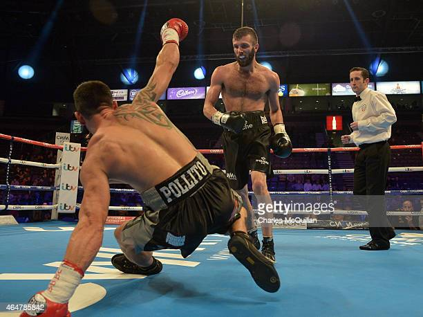 Anthony Cacace knocks down Santiago Bustos during their Super Featherweight bout on the Frampton v Avalos undercard bill at Odyssey Arena on February...