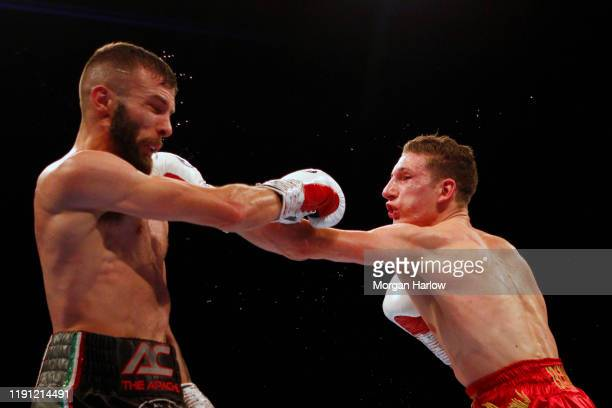 Anthony Cacace punches Sam Bowen during The British SuperFeatherweight between Sam Bowen and Anthony Cacace Arena Birmingham on November 30 2019 in...