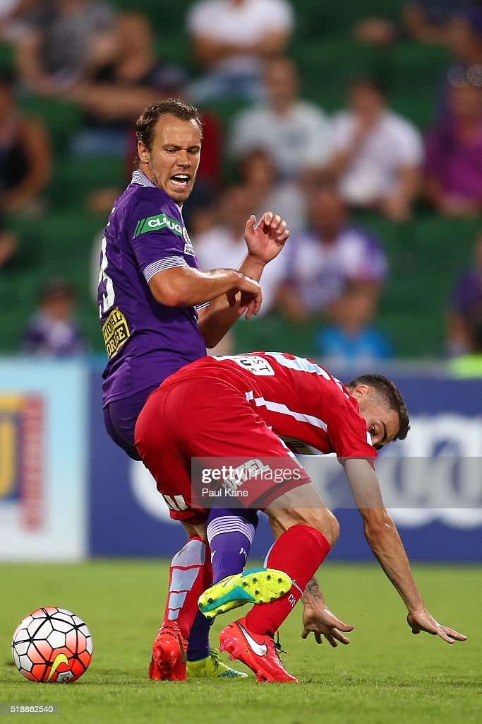 Anthony Caceres of Melbourne challenges Krisztian Vadocz of the Glory during the round 26 A-League match between the Perth Glory and Melbourne City FC at nib Stadium on April 3, 2016 in Perth, Australia.