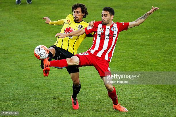 Anthony Caceres of Melbourne City and Albert Riera of the Phoenix compete for the ball during the round 21 ALeague match between the Wellington...