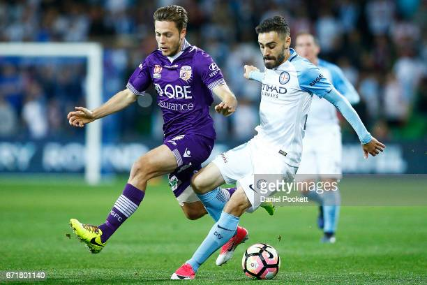 Anthony Caceres of Melbourne City and Dino Djulbic of the Glory contest the ball during the ALeague Elimination Final match between Melbourne City FC...