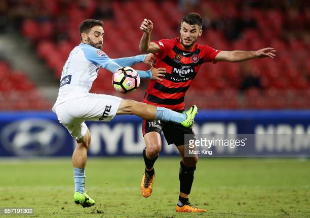Anthony Caceres of Melbourne City is challenged by Terry Antonis of the Wanderers during the round 24 ALeague match between the Western Sydney...