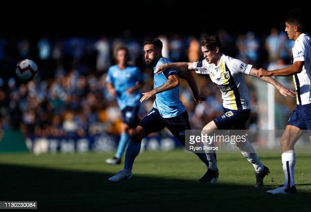 Anthony Caceres of Sydney FC competes for the ball against Stephen Mallon of the Mariners during the round 19 ALeague match between Sydney FC and the...