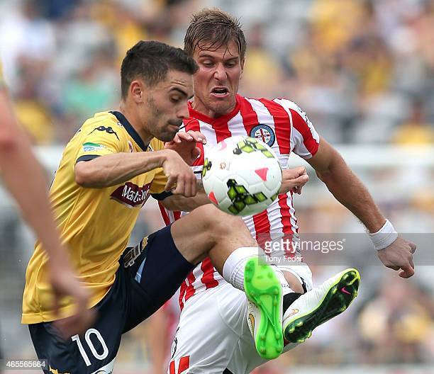 Anthony Caceres of the Mariners contests the ball with Erik Paartalu of Melbourne City during the round 20 ALeague match between the Central Coast...