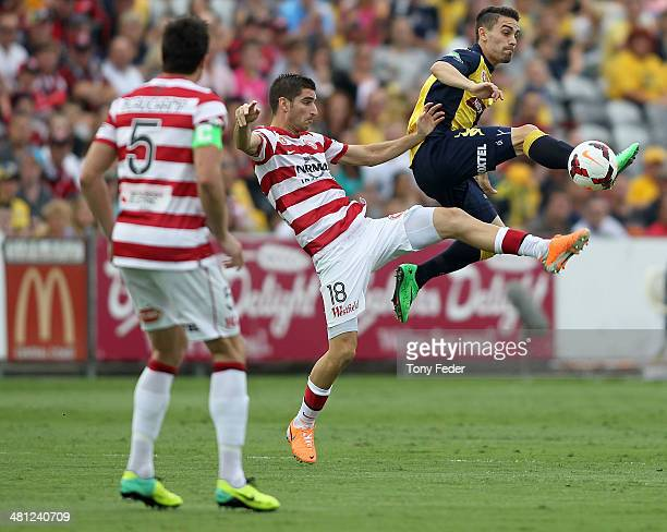 Anthony Caceres of the Mariners contests the ball with Iacopo La Rocca of the Wanderers during the round 25 ALeague match between the Central Coast...