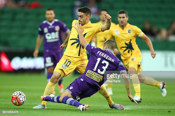 Anthony Caceres of the Mariners is challenged by Diogo Ferreira of the Glory during the round 10 ALeague match between the Perth Glory and the...