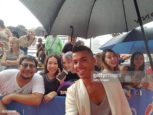 Anthony Callea poses for a selfie with fans ahead of the 30th Annual ARIA Awards 2016 at The Star on November 23 2016 in Sydney Australia