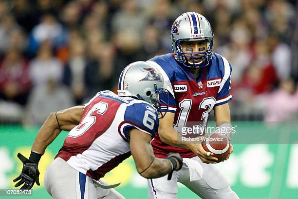 Anthony Calvillo of the Montreal Alouettes hands the ball to Avon Cobourne during the CFL Eastern Finals game against the Toronto Argonauts at the...