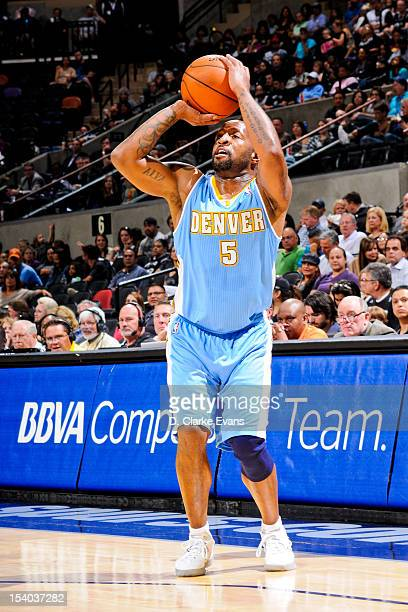 Anthony Carter of the Denver Nuggets attempts a threepoint shot against the San Antonio Spurs during a preseason game on October 12 2012 at the ATT...