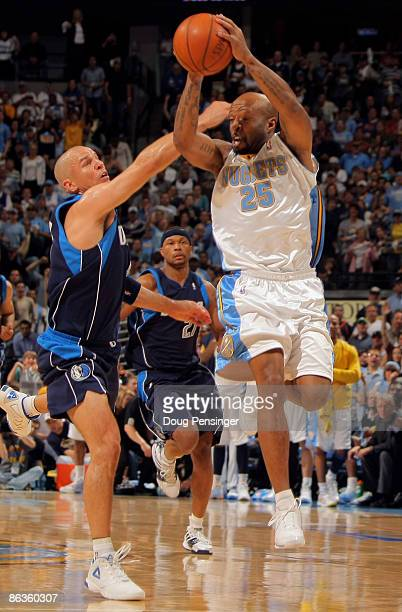 Anthony Carter of the Denver Nuggets collects a pass as Jason Kidd of the Dallas Mavericks defends in Game One of the Western Conference Semifinals...