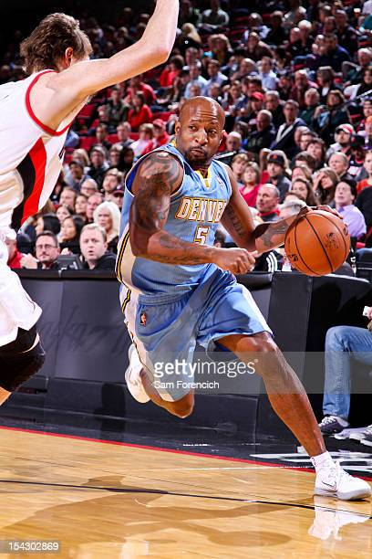 Anthony Carter of the Denver Nuggets drives against Coby Karl of the Portland Trail Blazers during a preseason game on October 17 2012 at the Rose...