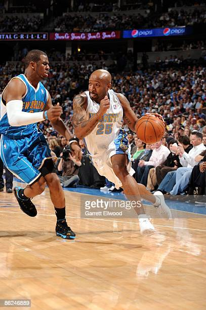 Anthony Carter of the Denver Nuggets drives to the basket against Chris Paul of the New Orleans Hornets in Game One of the Western Conference...