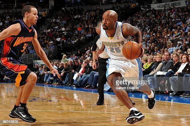 Anthony Carter of the Denver Nuggets drives to the basket against Stephen Curry of the Golden State Warriors during the game at Pepsi Center on...