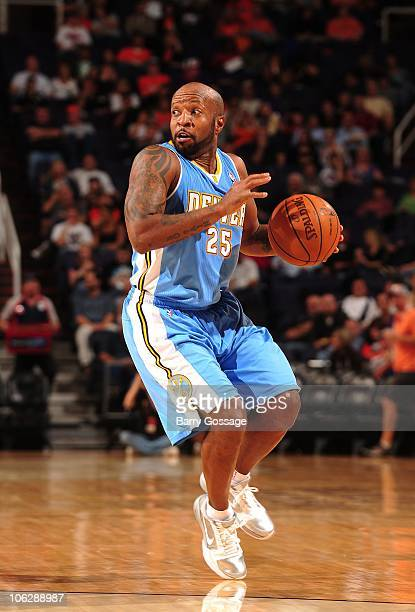 Anthony Carter of the Denver Nuggets looks for an opening during a preseason game against the Phoenix Suns on October 22 2010 at US Airways Center in...