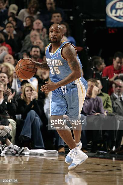 Anthony Carter of the Denver Nuggets moves the ball up court during the game against the Portland Trail Blazers at the Rose Garden Arena on February...