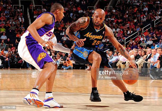 Anthony Carter of the Denver Nuggets posts up against Leandro Barbosa of the Phoenix Suns during the game at US Airways Center on April 13 2010 in...