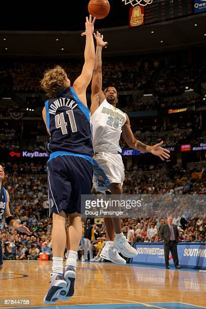 Anthony Carter of the Denver Nuggets puts up a shot over Dirk Nowitzki of the Dallas Mavericks in Game Five of the Western Conference Semifinals...