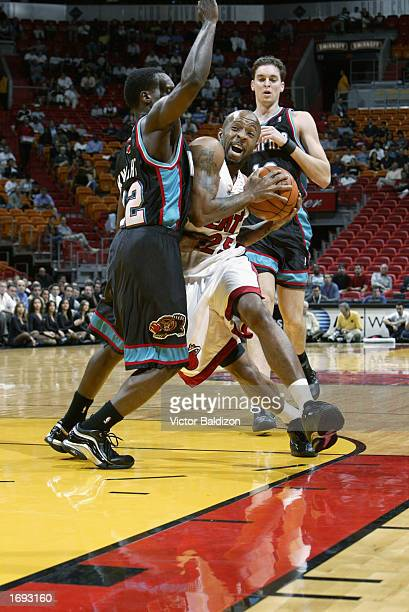 Anthony Carter of the Miami Heat drives against Brevin Knight of the Memphis Grizzlies during the game at American Airlines Arena on December 10 2002...