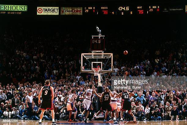 Anthony Carter of the Miami Heat hits the game winning shot against the New York Knicks in Game Three of the Eastern Conference Semifinals during the...