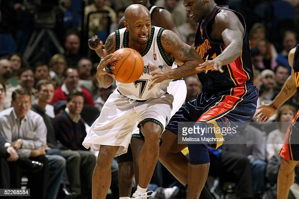 Anthony Carter of the Minnesota Timberwolves drives to the basket against Adonal Foyle of the Golden State Warriors on March 02 2005 at the Target...