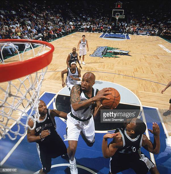 Anthony Carter of the Minnesota Timberwolves drives to the basket against Tony Massenburg and Mike Wilks of the San Antonio Spurs during the NBA game...